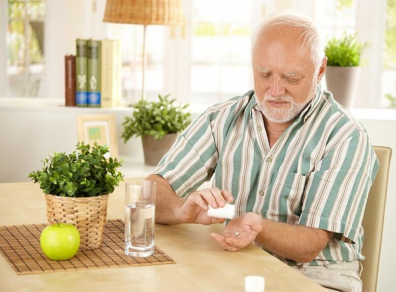 elderly_taking_pills.jpg